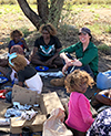 Elders and young people at a bush picnic in the APY Lands