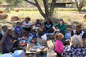 Elders and young people sharing food and knowledge at a bush picnic in the APY Lands