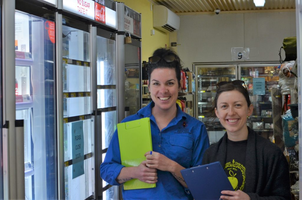 Rhiannon Hutchinson and Sara Bamford carrying out store suvey work, Mimili