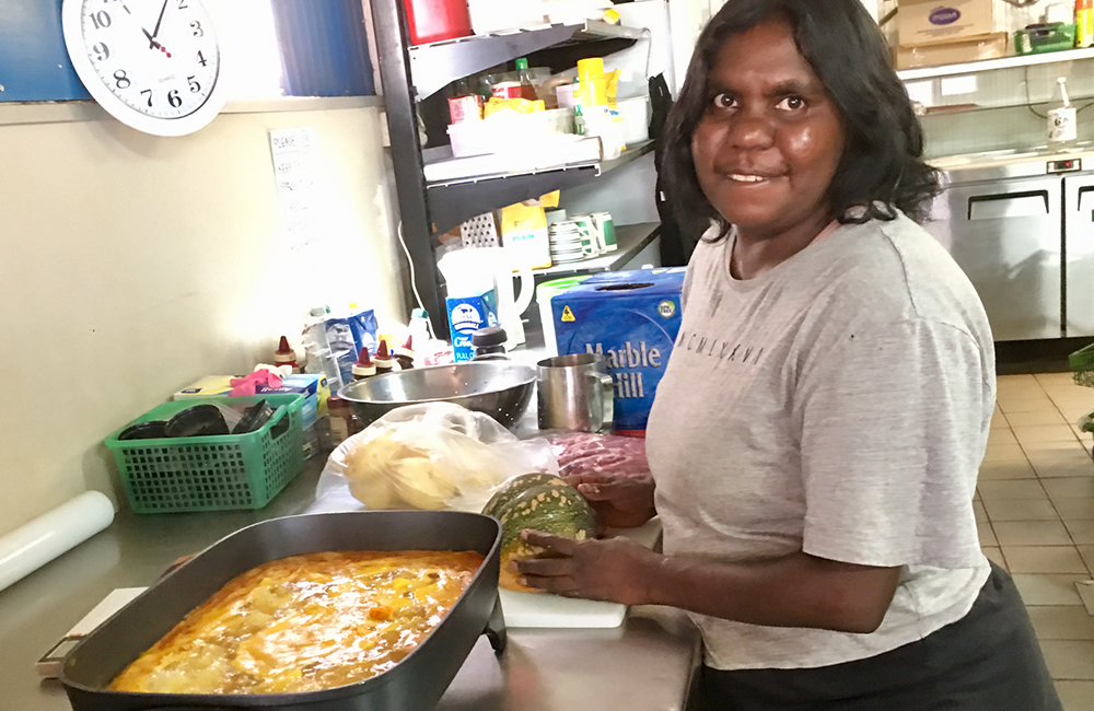Image of Store worker Sandra Wilson cooking a healthy take-away meal, Amata
